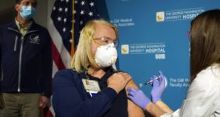 US begins COVID-19 vaccinations as its death toll passes 300,000